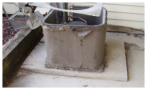 Residential air conditioning unit with clogged coil fins